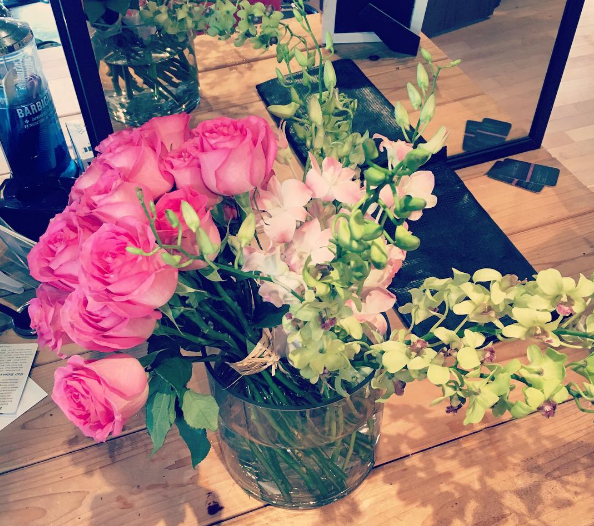 """CHICAGO - On July 8 2016, Bank of America exec Mario Elizondo fraudulently ordered THESE roses delivered in a glass vase to Jorge """"George"""" Cadenas at Mane Space the second day he was there. A Plus Flowers, a small family-owned business in downtown Chicago, that prides itself on its quality and service was defrauded of $165.38 in the transaction. There are many of other fraudulent flower purchases. If you believe you were defrauded contact IDTheftReport2020.com 2016 All rights reserved IDTheftReport2020.com"""