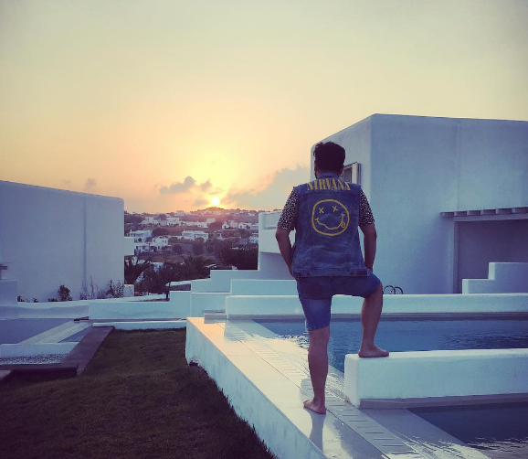 SUNRISE MYKONOS GREECE -Bank of America Banco Bandito Mario Elizondo watches the sunrise from The Mykonian Resort Hotel in August 2016 - just one more business establishment on a very long list of businesses Elizondo and Jorge Cadenas and their associates have defrauded using a host of methods. 2016 All rights reserved IDTheftReport2020.com