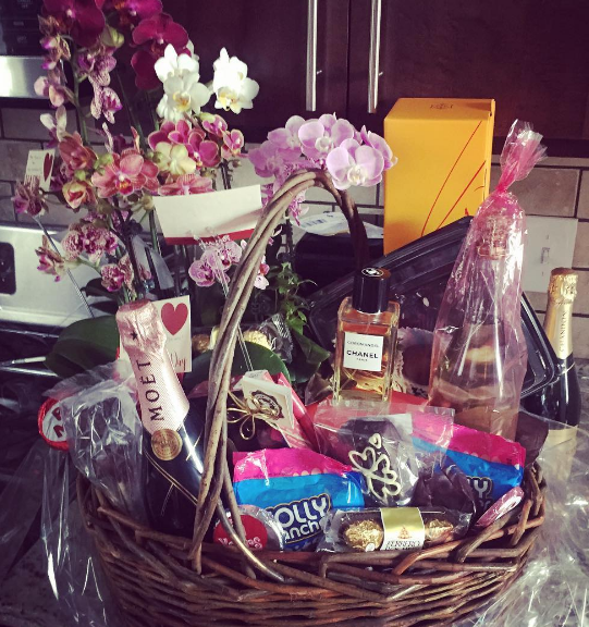 CHICAGO - Conspicuus consumption on steriods! This 2016 Valentines Day basket - in the fraudster couples Wicker Park Thomas Street apartment kitchen - contained literally thousands of dollars of fraudulently obtained goods - including leather designer accessories, CHANEL Coromandel cologne, Moet champagnes and many other high-ticket items. 2016 All rights reserved IDTheftReport2020.com