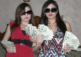 """CHICAGO World traveler Pa1loma Garcia [RIGHT] lives the life of a millionaire. Like her associate Jorge Cadenas, Pa1oma Garcia brags she's been a """"hustler from day one."""" 2016 All rights reserved. IDTheftReport2020.com"""